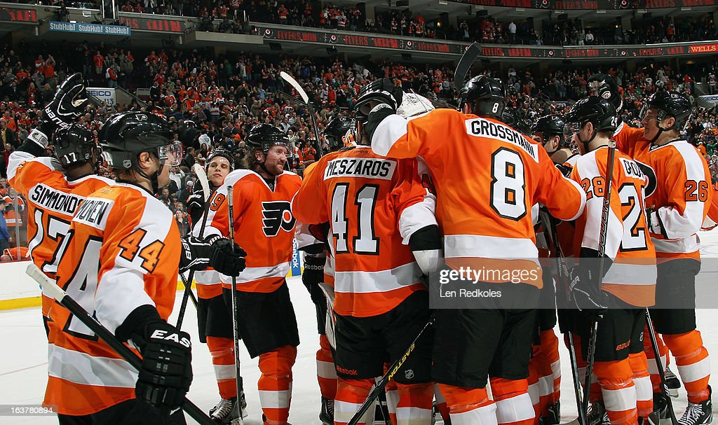Members of the Philadelphia Flyers celebrate after defeating the New Jersey Devils 2-1 in a shoot-out on March 15, 2013 at the Wells Fargo Center in Philadelphia, Pennsylvania.
