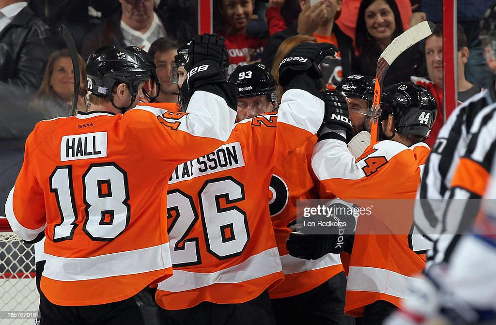 Members of the Philadelphia Flyers celebrate after defeating the New York Rangers 2-1 on October 24, 2013 at the Wells Fargo Center in Philadelphia, Pennsylvania.