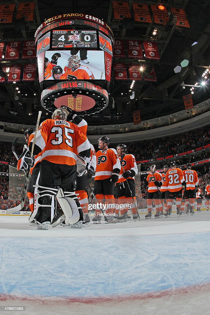 Members of the Philadelphia Flyers congratulate Steve Mason #35 after shutting out the Pittsburgh Penguins 4-0 on March 15, 2014 at the Wells Fargo Center in Philadelphia, Pennsylvania.