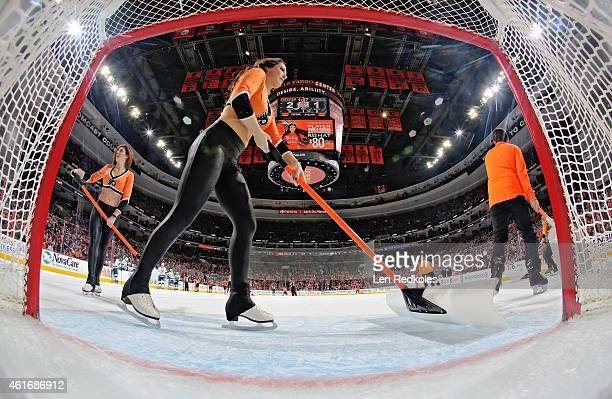 Members of the Philadelphia Flyers Ice Crew clean the ice during a stoppage in play against the Tampa Bay Lightning on January 12 2015 at the Wells...