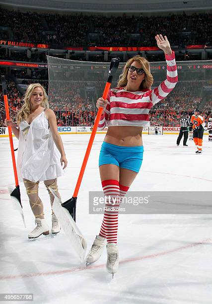 Members of the Philadelphia Flyers ice girls wear their Halloween costumes as they skate off the ice during a NHL game against New Jersey Devils on...