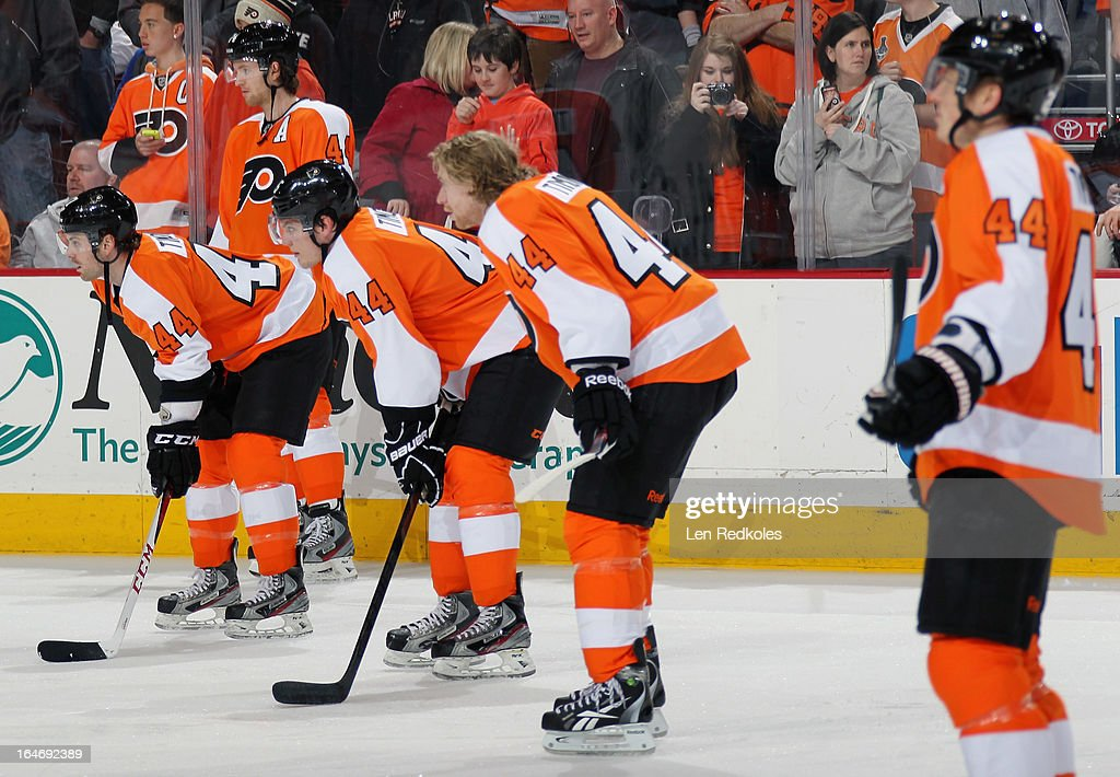 Members of the Philadelphia Flyers look on during warmups prior to their game against the New York Rangers on March 26, 2013 at the Wells Fargo Center in Philadelphia, Pennsylvania. The Philadelphia Flyers are all wearing the jersey of teammate Kimmo Timonen #44 in honor of him playing in his 1,000th NHL game last week.