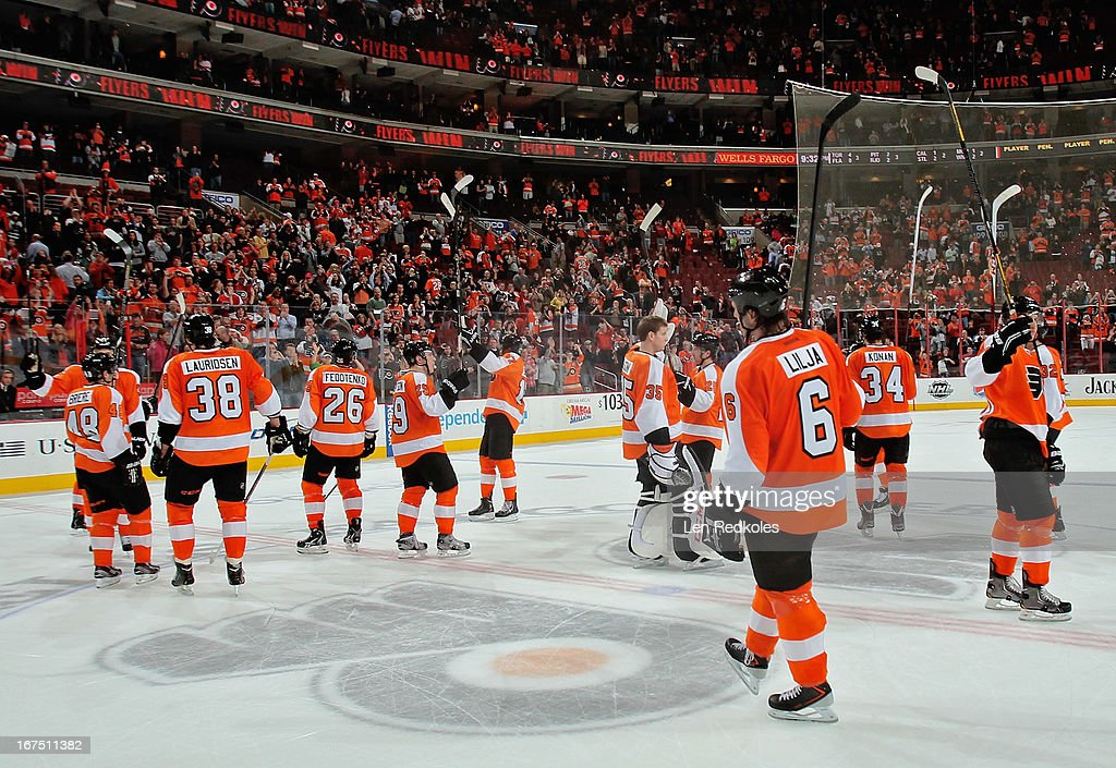 Members of the Philadelphia Flyers salute the fans after defeating the New York Islanders 2-1 on April 25, 2013 at the Wells Fargo Center in Philadelphia, Pennsylvania.