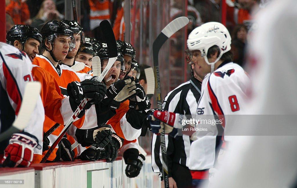 Members of the Philadelphia Flyers stare down Alex Ovechkin #8 of the Washington Capitals on February 27, 2013 at the Wells Fargo Center in Philadelphia, Pennsylvania.