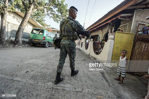 Members of the Philippine Marine Corps in Zamboanga City go on an early morning patrol It was in this neighborhood in September 2013 that government...