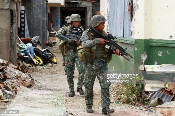 Members of the Philippine Marines 1st Brigade conduct clearing operation at the main battle zone to liberate the ruined city from the presence of...
