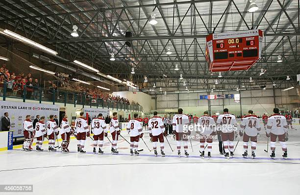 Members of the Phoenix Coyotes line up for the national anthems prior to facing the Calgary Flames during Day 4 of NHL Kraft Hockeyville at the...