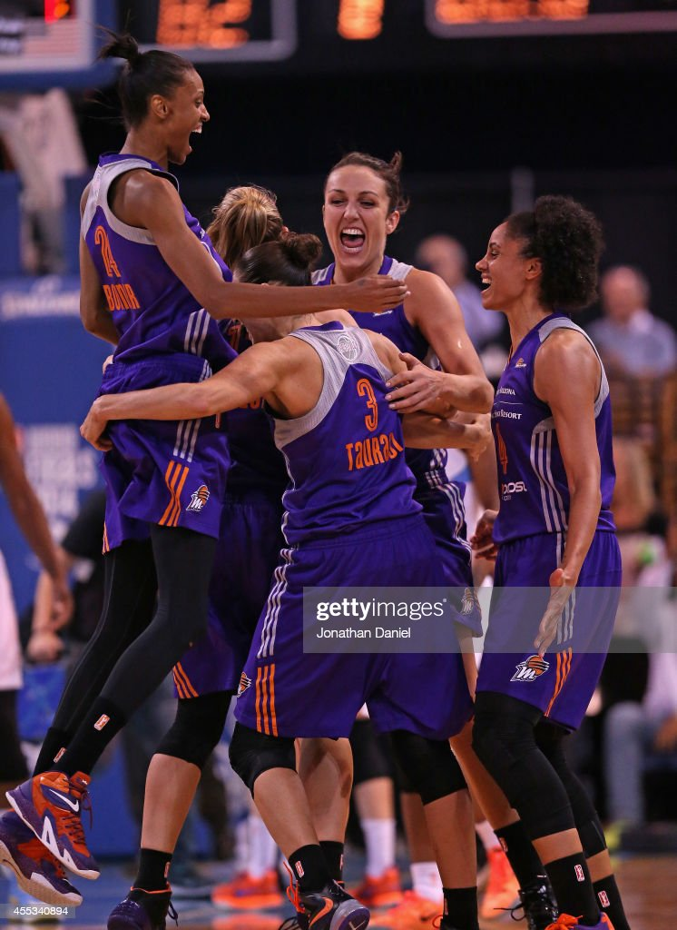 Members of the Phoenix Mercury including (L-R) DeWanna Bonner #24, Diana Taurasi #3, Ewelina Kobryn #11 and Candice Dupree #4 celebrate a championship win over the Chicago Sky during game three of the WNBA Finals at the UIC Pavilion on September 12, 2014 in Chicago, Illinois. The Mercury defeated the Sky 87-82 to win the championship.