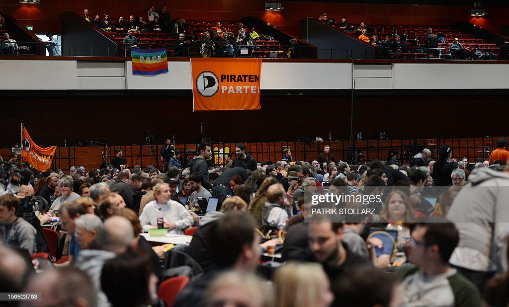 Members of the Pirate party follow a discussion at a party congress in Bochum, western Germany, on November 25, 2012. The Pirate Party is meeting for two days to prepare a party platform for the 2013 general elections. AFP PHOTO / PATRIK STOLLARZ
