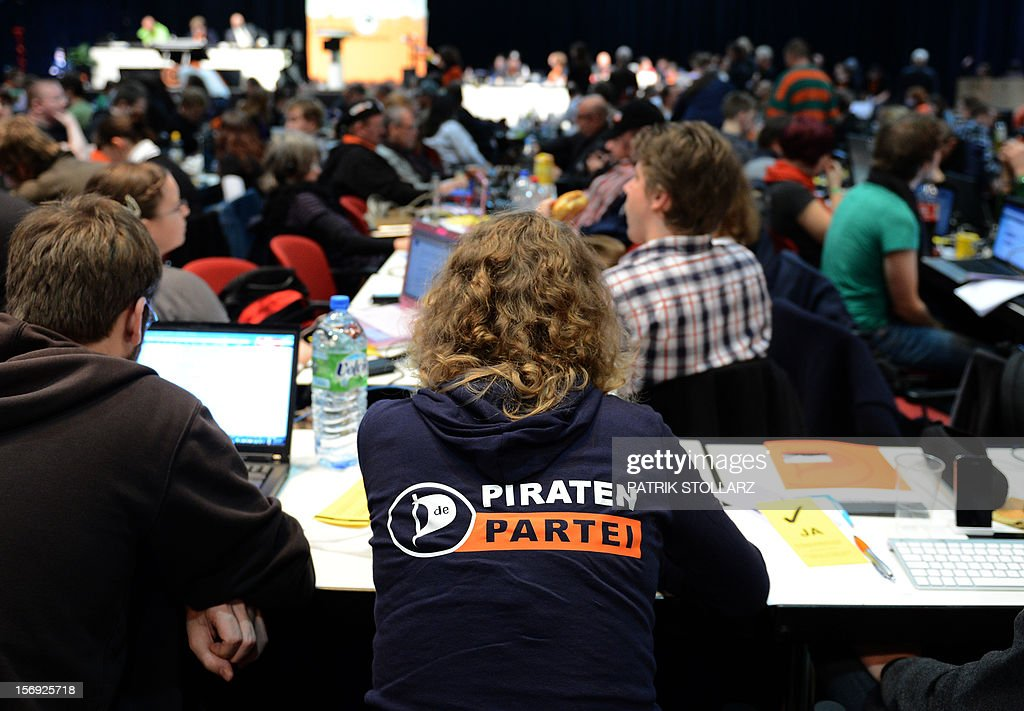 Members of the Pirate party follow a discussion at a party congress in Bochum, western Germany, on November 25, 2012. The Pirate Party is meeting for two days to prepare a party platform for the 2013 general elections.