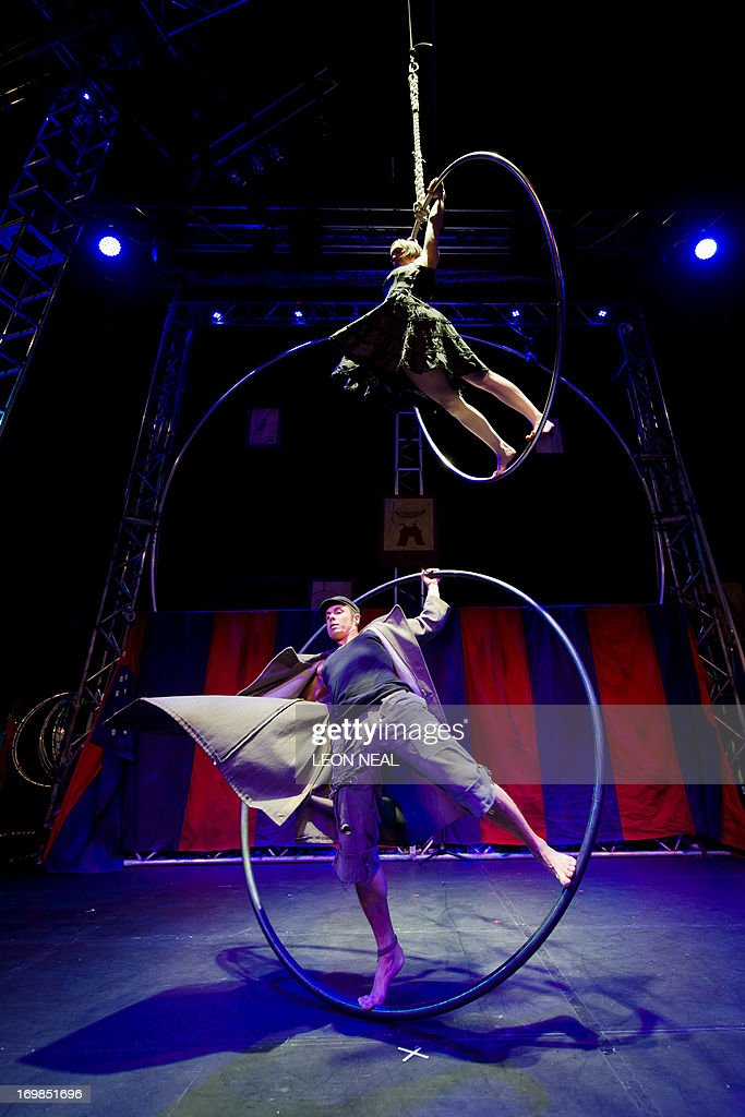 Members of the Pirates of the Carabina aerialist team perform sections of their show 'Flown' during a press event at the Udderbelly festival in...