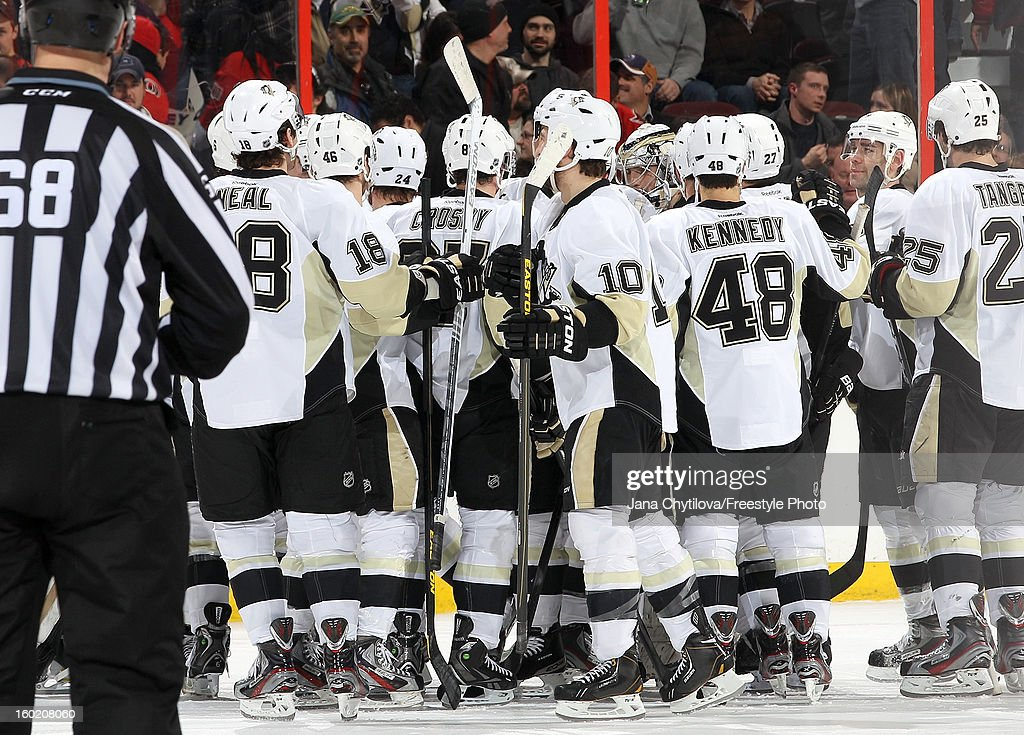 Members of the Pittsburgh Penguins celebrate their shoot-out win over the Ottawa Senators during an NHL game at Scotiabank Place on January 27, 2013 in Ottawa, Ontario, Canada.