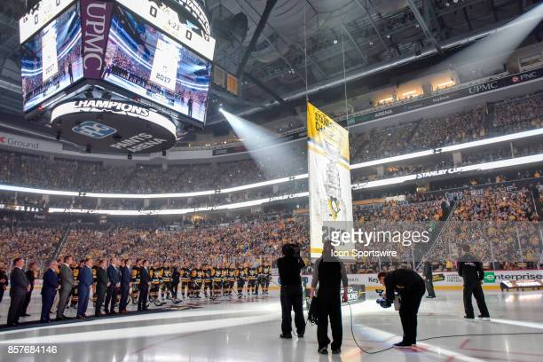 Members of the Pittsburgh Penguins watch as the 2017 Stanley Cup Banner is raised prior to the game against the St Louis Blues on October 4 at PPG...