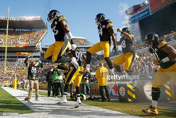Members of the Pittsburgh Steelers run onto the field before the start of the game against the Cleveland Browns at Heinz Field on November 15 2015 in...