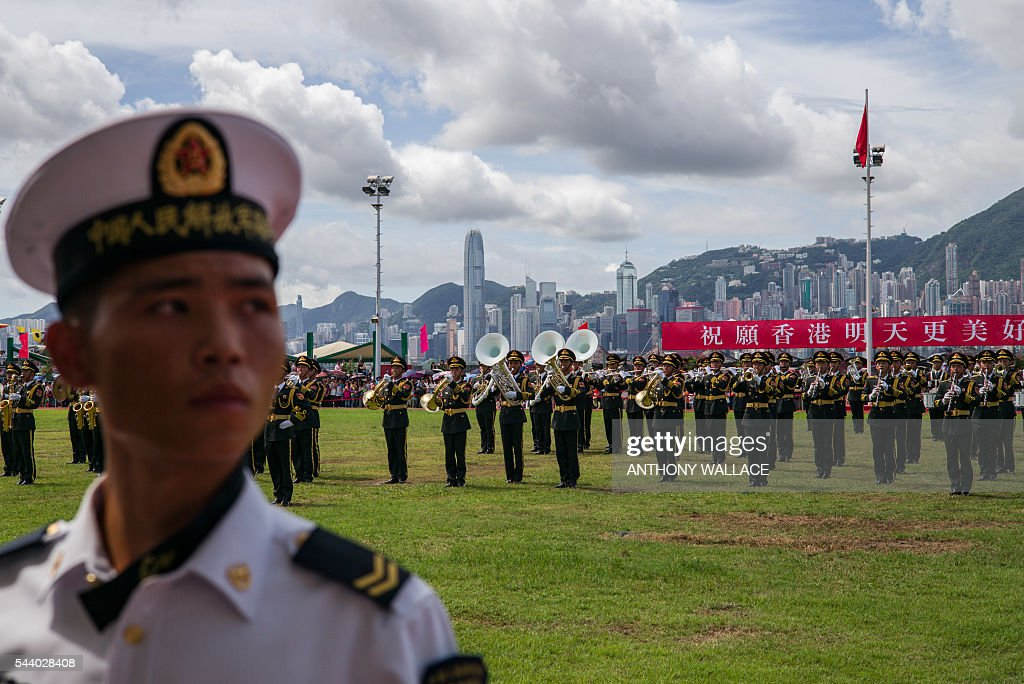 Members of the PLA and play during the open day of the Chinese People's Liberation Army (PLA) Navy Base at Stonecutter Island in Hong Kong on July 1, 2016, to mark the 19th anniversary of the Hong Kong handover to China. / AFP / Anthony Wallace