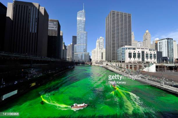 Members of the plumbers' union dye the Chicago River green for St Patrick's Day on March 17 2012 in Chicago Illinois The River was first dyed green...