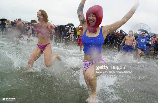 Members of the Polar Bear Club take to the frigid waters of the Atlantic Ocean off of Coney Island during the group's 100th annual New Year's Day...
