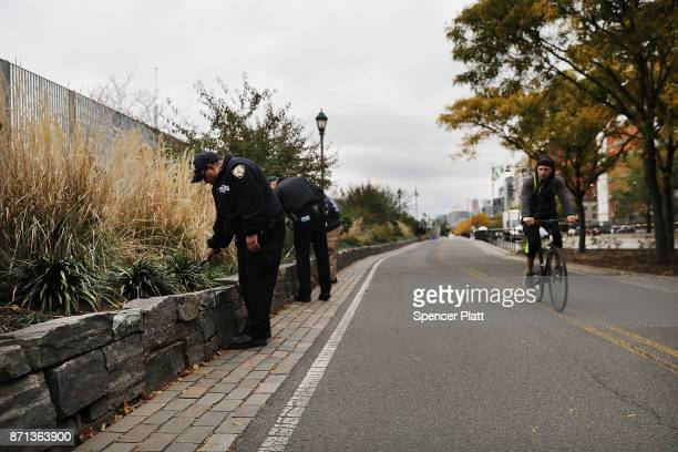 Members of the police department's crime scene unit search the location where terrorist Sayfullo Saipov drove down a Manhattan bike path and went on...