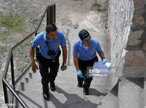 Members of the Police Investigations Direction work inside the 'Mary de Flores' Institute where a body wrapped in a sheet and nylon was found by...