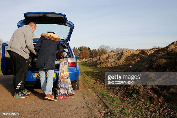 Members of the police search a car for illegal firework during a control near the German border in Coevorden on December 30 2015 / AFP / ANP / Bas...