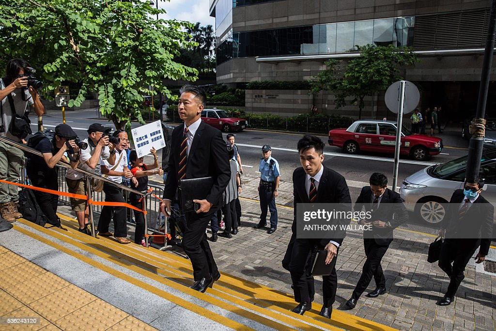Members of the police, who allegedly beat activist Ken Tsang (not pictured) during the 2014 pro-democracy protests, arrive outside the District Court in Hong Kong on June 1, 2016. Seven Hong Kong police officers appeared in court on June 1 over the beating of a pro-democracy protester during mass rallies in 2014, an incident which was captured on film and beamed around the world. / AFP / ANTHONY