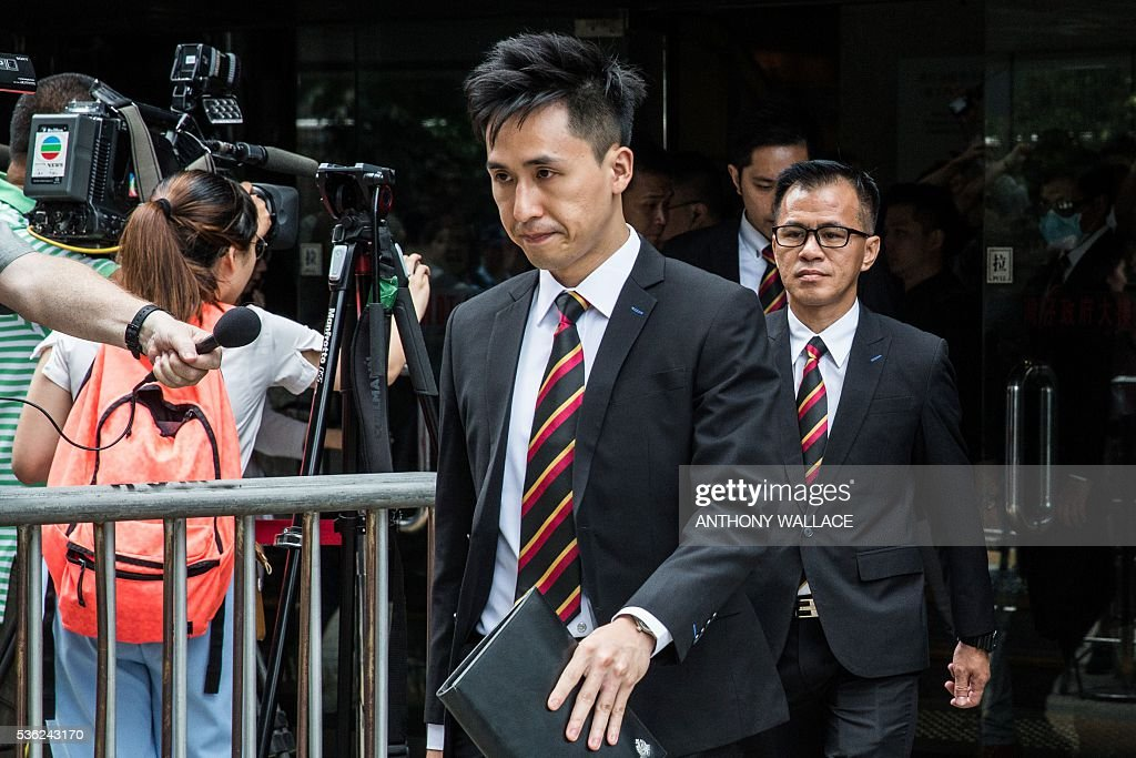 Members of the police (wearing black suits), who allegedly beat Civic Party activist Ken Tsang Ken Tsang (not pictured) during the 2014 pro-democracy protests, leave the District Court in Hong Kong on June 1, 2016. Seven Hong Kong police officers appeared in court on June 1 over the beating of a pro-democracy protester during mass rallies in 2014, an incident which was captured on film and beamed around the world. / AFP / ANTHONY