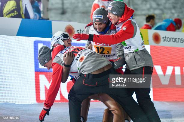Members of the Polish Team Kamil Stoch Piotr Zyla Dwid Kubacki Maciej Kot celebrate after Poland takes the GOLD in Men Large Hill Team final in ski...