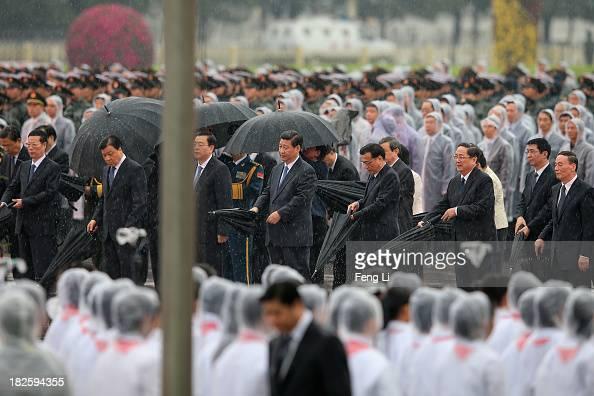 Members of the Politburo Standing Committee Zhang Gaoli Liu Yunshan Zhang Dejiang Xi Jinping Li Keqiang Yu Zhengsheng Wang Qishan and Chinese...