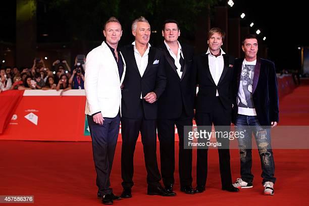 R Members of the pop band Spandau Ballet Gary Kemp Martin KempTony Hadley Steve Norman and John Keeble attend attend the 'Soul Boys of the Western...