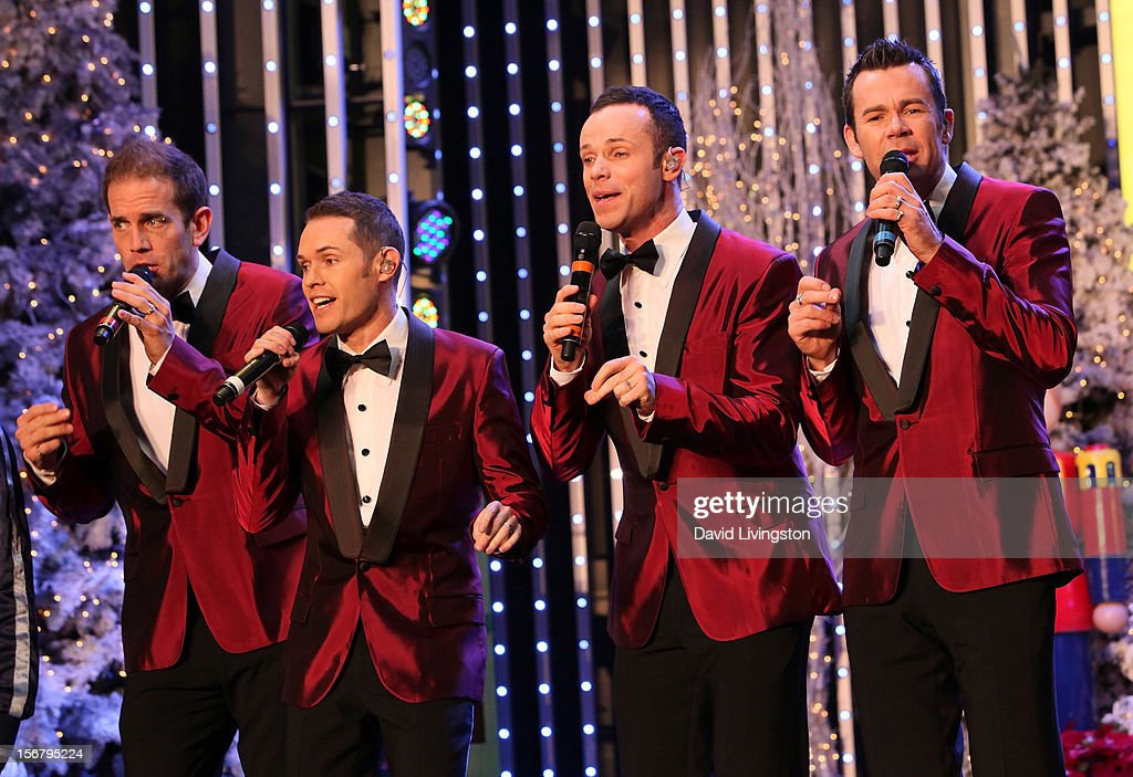 Members of the pop group Human Nature perform on stage at the Universal CityWalk Tree Lighting - Light Show Spectacular at 5 Towers Outdoor Concert Arena on November 20, 2012 in Universal City, California.