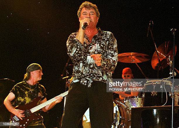 Members of the popular British rock group 'Deep Purple' Roger Glover Ian Gillan and Ian Paice perform during a live concert in Bangalore 01 April...