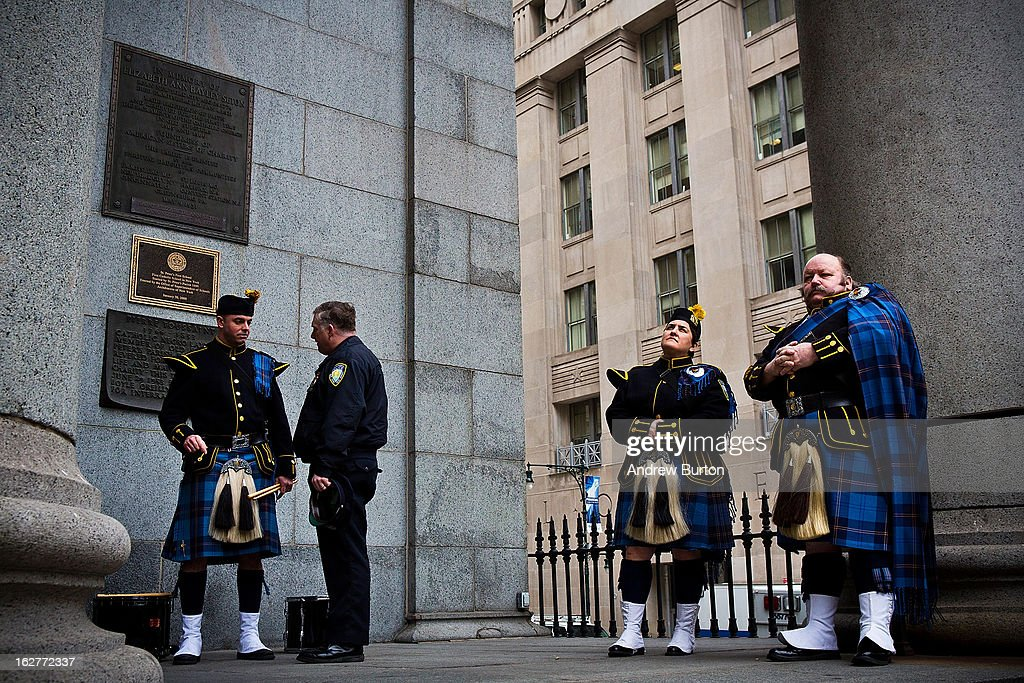Members of the Port Authority Pipes and Drums band wait outside during mass at St. Patrick's Roman Catholic Church, prior to the 20th Anniversary Ceremony for the 1993 World Trade Center bombing at Ground Zero on February 26, 2013 in New York City. The attack, which utilized a car bomb and hit the north tower, killed six people.