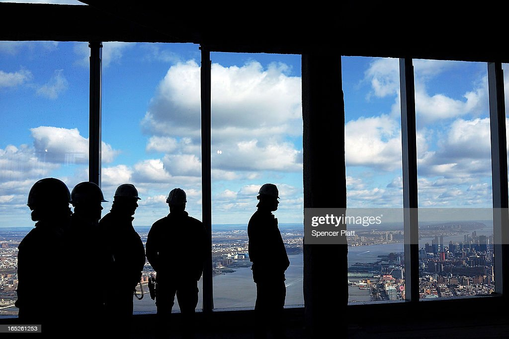 Members of the Port Authority Police stand near the windows in the One World Observatory from the 100th floor of One World Trade Center at the Ground Zero site on April 2, 2013 in New York City. One World Observatory, which is situated more than 1,250 feet over lower Manhattan, will open to the public in 2015 and will include a pre-show theater, multiple spaces that allow for panoramas of the New York City region and numerous dining options. When completed, One World Trade Center will be the tallest building in the Western Hemisphere at 1776 feet.