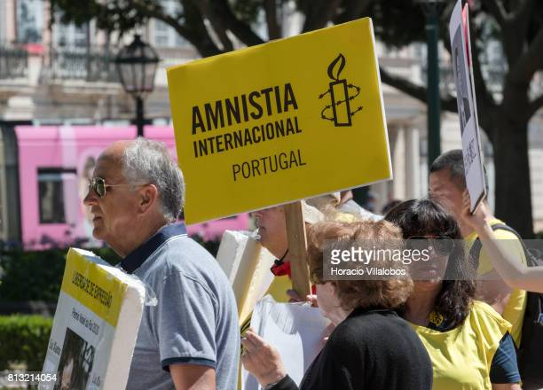 Members of the Portuguese chapter of Amnesty International demonstrate outside Belem Palace in favor of Chinese 2010 Nobel Peace Prize winner Liu...