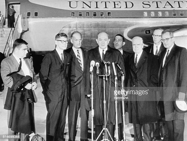 Members of the President Kennedy's cabinet speak to the press after learning of the president's assassination The men had been en route to Japan when...