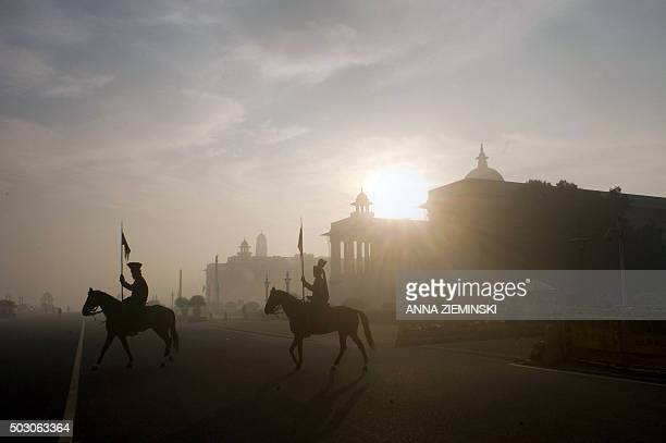 TOPSHOT Members of the President's Bodyguard a cavalry regiment of the Indian Army patrol near Rashtrapati Bhawan the official home of the Indian...