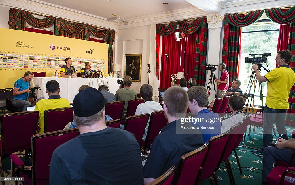 Members of the press attend a Borussia Dortmund press conference with Director of Communication Sasha Fligge (L) and Head coach Juergen Klopp (BVB) of Borussia Dortmund on August 1, 2014 in Bad Ragaz, Switzerland.