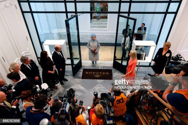 Members of the press photograph and film First Lady of Turkey Emine Gulbaran Erdogan as she arrives for a visit of to a shop of Belgian fashion label...