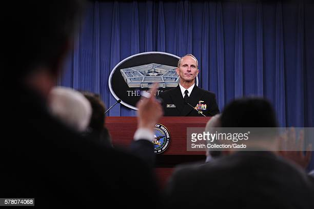 Members of the press raise their hands to ask Chief of Naval Operations CNO Admiral Jonathan Greenert questions during a press conference to update...