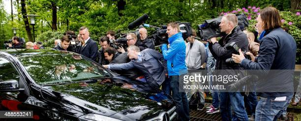 Members of the press throw themselves on Netherlands' national football team forward player Davy Klaassen who arrives for a training session in...