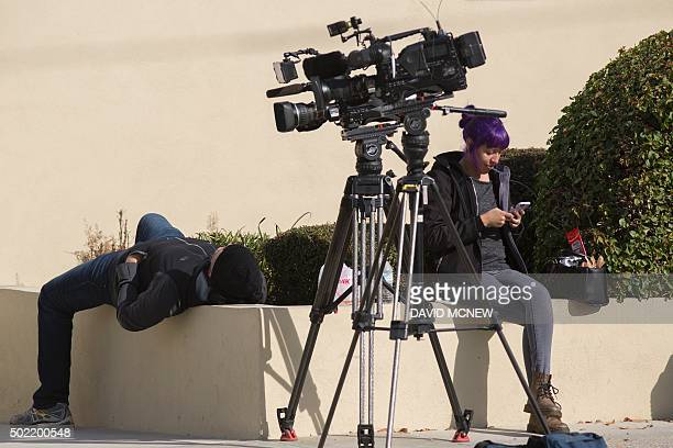 Members of the press wait for Enrique Marquez to depart from his detention hearing in federal court in Riverside California December 21 2015 Enrique...