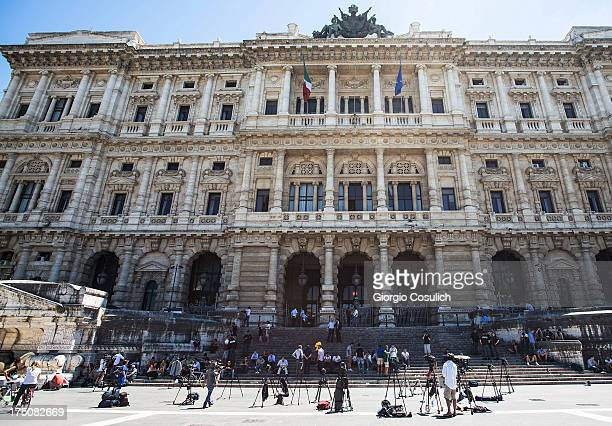 Members of the press wait in front of the 'Corte di Cassazione' or Supreme Court during the final arguments as former Italian Prime Minister Silvio...