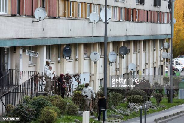 Members of the 'Prevention Public safety and Tranquility' service of ClichysousBois work on November 13 at the entrance of an apartment building at...