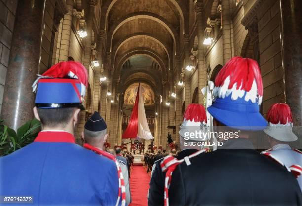 Members of the Prince of Monaco's Company of Carabiniers attend a mass at the Saint Nicholas cathedral during the celebrations marking Monaco's...