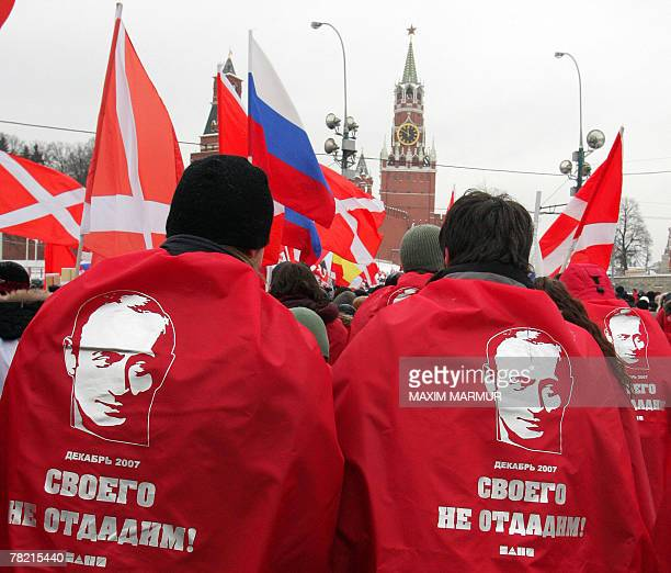 Members of the proKremlin youth group Nashi hold a rally near Red Square in central Moscow 03 December 2007 to celebrate the overwhelming victory by...