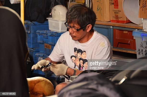 A members of the props department working on dummies on the Hong Kong film set of Rigor Mortis a horror film about vampires The film is Juno Mak's...