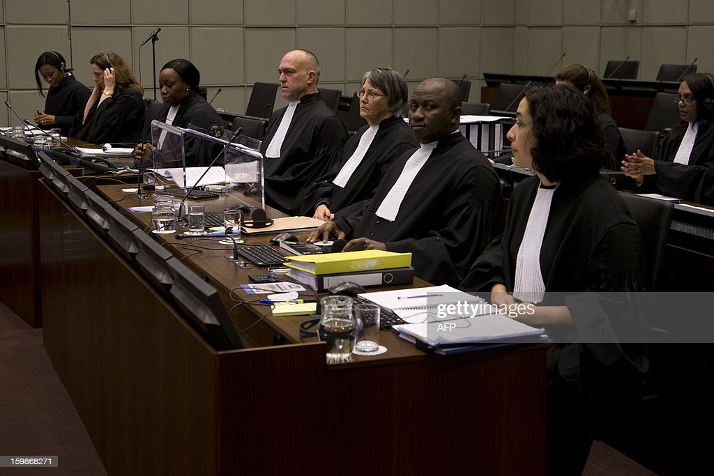 Members of the prosecution, Brenda J. Hollis (front row, 3rd R), Nicholas Koumjian (front, 4th R), Mohammed Bangura (2nd R) and Nina Tavakoli (R) wait on January 22, 2013 for the start of the appeals hearing of former Liberian President Charles Taylor at the Special Court for Sierra Leone in Leidschendam, The Netherlands. The former Liberian warlord began his appeal at the Special Court for Sierre Leone's against his 50-year prison sentence for fuelling the west African nation's savage civil war. Appeals judges are to hear arguments from prosecutors demanding a heavier sentence and from the former strongman's lawyers calling for his 50-year sentence to be quashed or reduced. Judges said he aided and abetted rebel forces fighting against Freetown during Sierra Leone's 10-year civil war, known for its mutilations, drugged child soldiers and sex slaves. AFP PHOTO / POOL / PETER DEJONG - netherlands out -