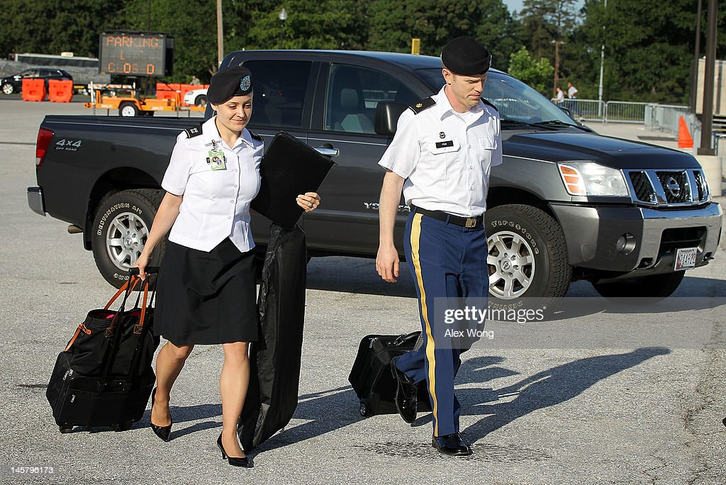 Members of the prosecution team, (L-R) Captain Angel Overgaard and Major Ashden Fein, arrive for a motion hearing in the case United States vs. Pfc. Bradley E. Manning June 6, 2012 in Fort Meade, Maryland. Manning, an Army intelligence analyst who has been accused of passing thousands of diplomatic cables and intelligence reports to the whistleblowing website WikiLeaks and facing 22 charges including aiding the enemy, returned to the court room to ask for dismissal of 10 of the charges.