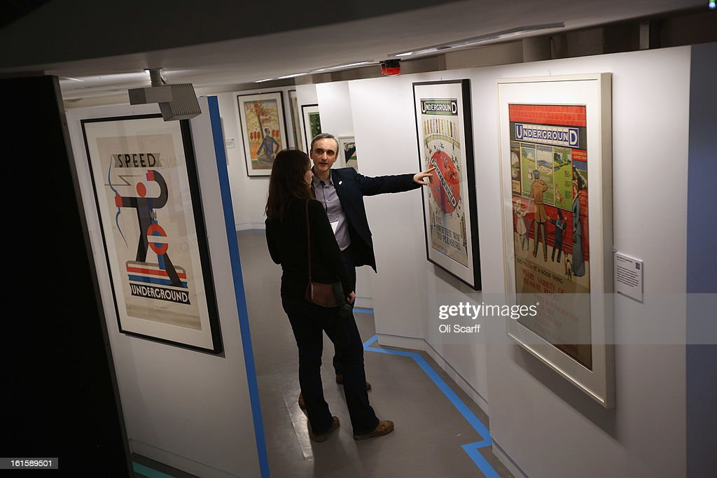 Members of the public admire posters on display in the exhibition 'Poster Art 150 - London Underground's Greatest Designs' in the London Transport Museum on February 12, 2013 in London, England. The exhibition celebrates 150 years of the London Underground by showcasing 150 posters from the Museum's archive of over 3,300. The exhibition opens on February 15, 2013 and runs until October 27, 2013.