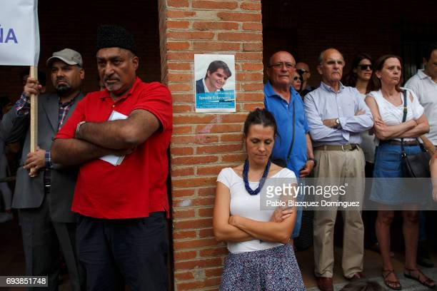 Members of the public amid muslim men attend a vigil in tribute to Ignacio Echavarria a victim of the London terror attack outside of Las Rozas City...